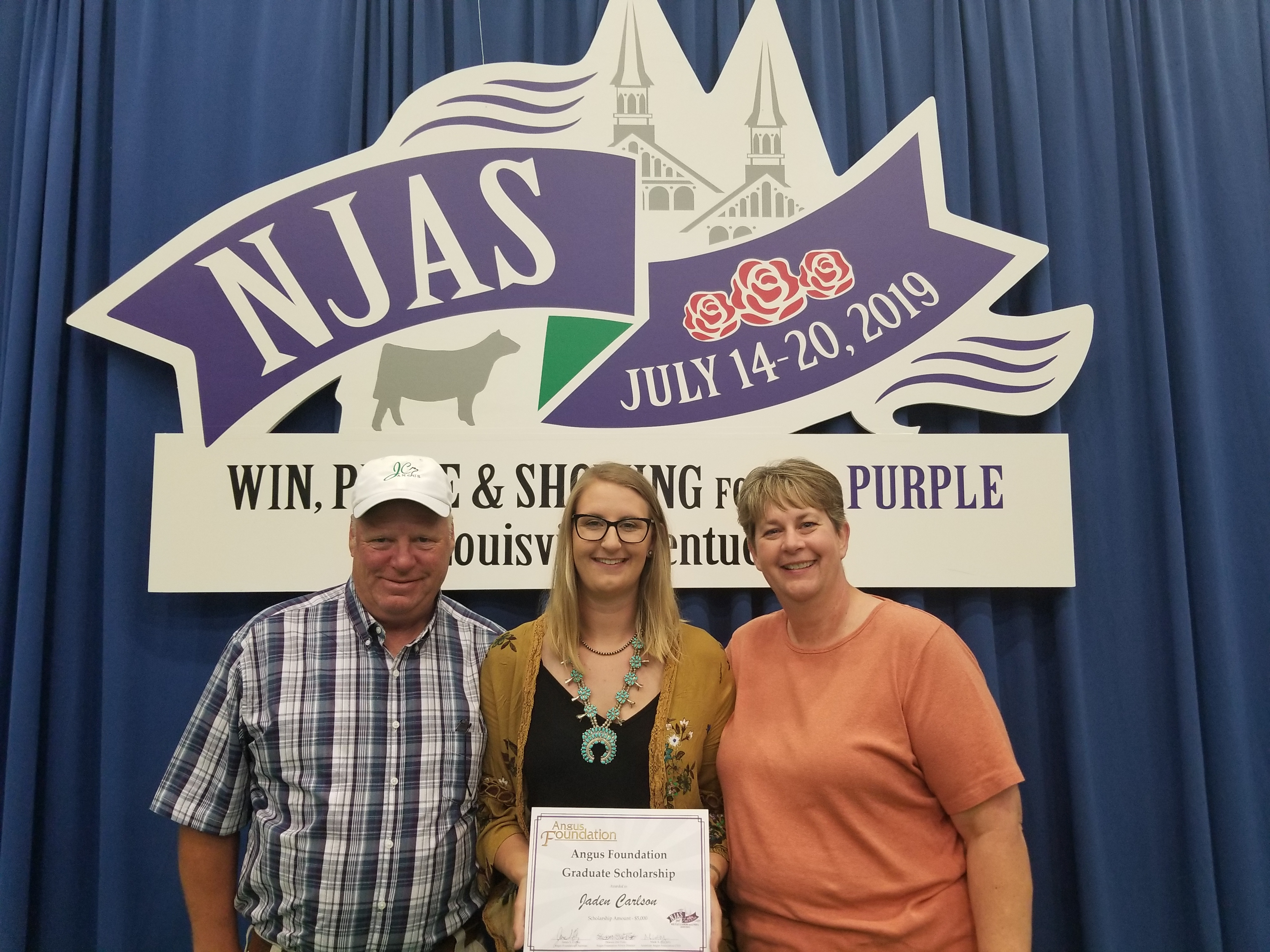 Jaden Carlson receives a scholarship from the Angus Foundation